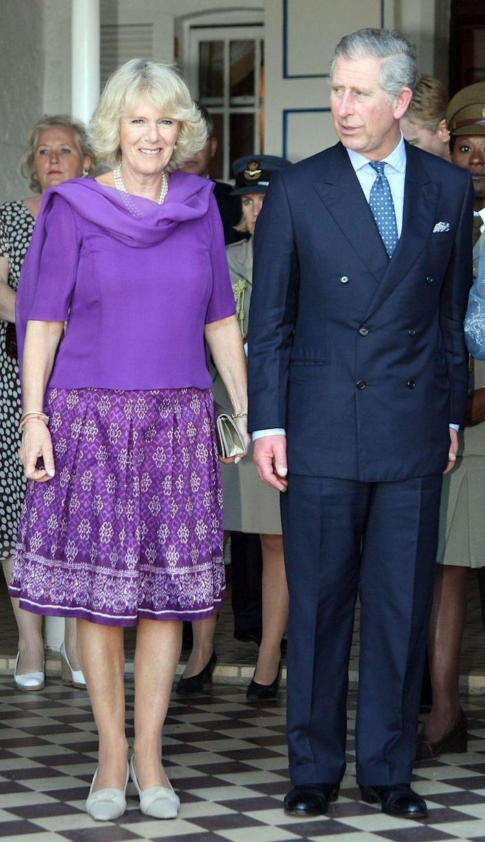<p>In St. Lucia, as part of Charles and Camilla's Royal Tour of the Caribbean, Camilla donned this brilliant purple combo with a flowy, blousy top and a patterned skirt. </p>