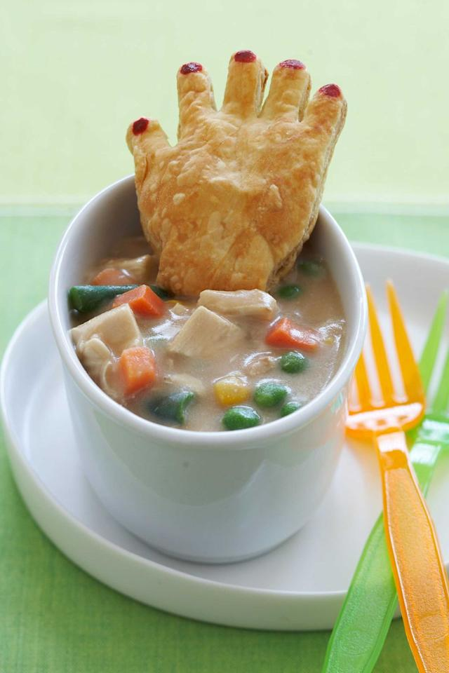 "<p>This savory pot pie is packed with veggies and protein to keep your <a href=""https://www.womansday.com/home/crafts-projects/how-to/g510/10-easy-to-make-kids-costumes-124463/"" target=""_blank"">little ghost or goblin </a>well nourished for the night ahead.</p><p><em><a href=""https://www.womansday.com/food-recipes/food-drinks/recipes/a11095/chicken-potpie-crawling-hands-recipe-122451/"" target=""_blank"">Get the recipe for Chicken Pot Pie With Crawling Hands.</a></em></p><p><strong>What you'll need</strong>: <a href=""https://www.amazon.com/Ann-Clark-Hand-Cookie-Cutter/dp/B00KJ8M9YI/ref=sr_1_17_sspa?keywords=Wilton+hand-shaped+cookie+cutter&qid=1564425695&s=gateway&sr=8-17-spons&psc=1&smid=A1MHVA9P45JS92&spLa=ZW5jcnlwdGVkUXVhbGlmaWVyPUExQ0NZUk9HWUVQU0g5JmVuY3J5cHRlZElkPUEwMjE5NjAxTURRNFpEOFJIVTVCJmVuY3J5cHRlZEFkSWQ9QTA3MTE0NjUzMjhKUjM5Rks2U0tHJndpZGdldE5hbWU9c3BfbXRmJmFjdGlvbj1jbGlja1JlZGlyZWN0JmRvTm90TG9nQ2xpY2s9dHJ1ZQ=="" target=""_blank"">Wilton hand-shaped cookie cutter</a> ($5, amazon.com)</p>"
