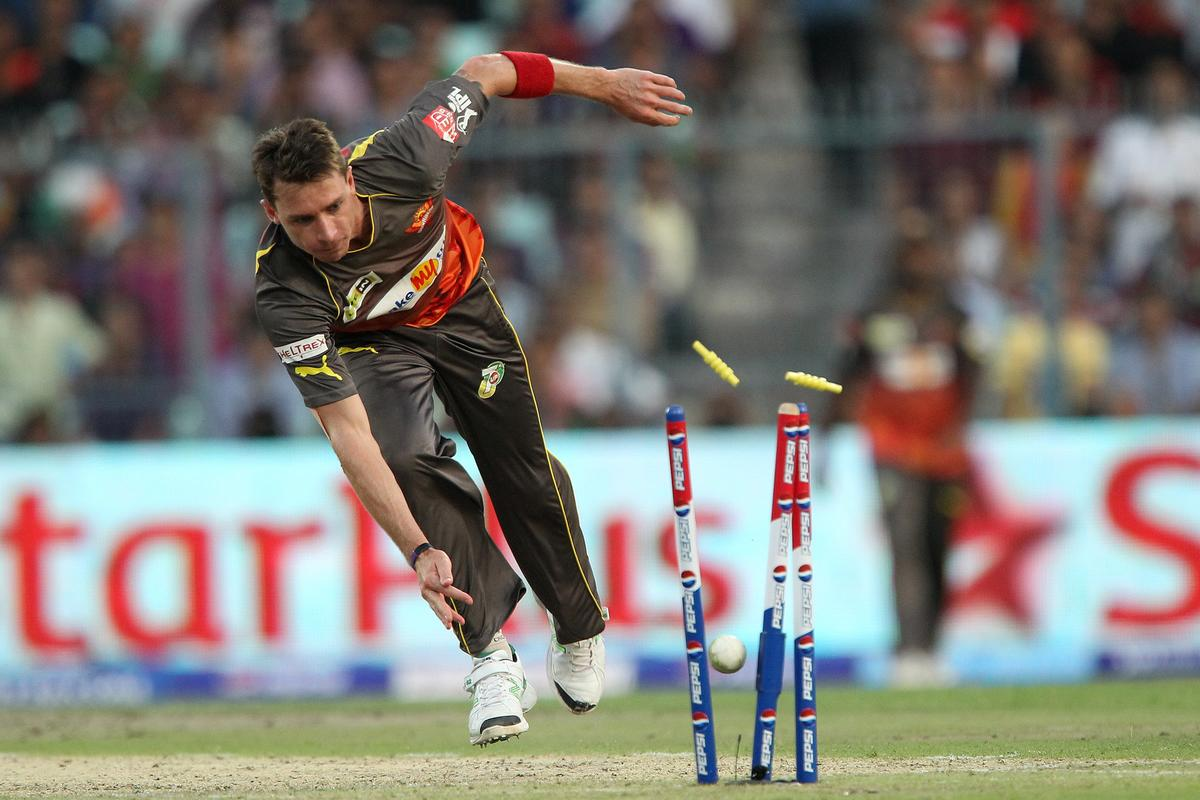Dale Steyn breaks the wicket as he turns out Eoin Morgan during match 17 of the Pepsi Indian Premier League between The Kolkata Knight Riders and the Sunrisers Hyderabad held at the Eden Gardens Stadium in Kolkata on the 14th April 2013. (BCCI)