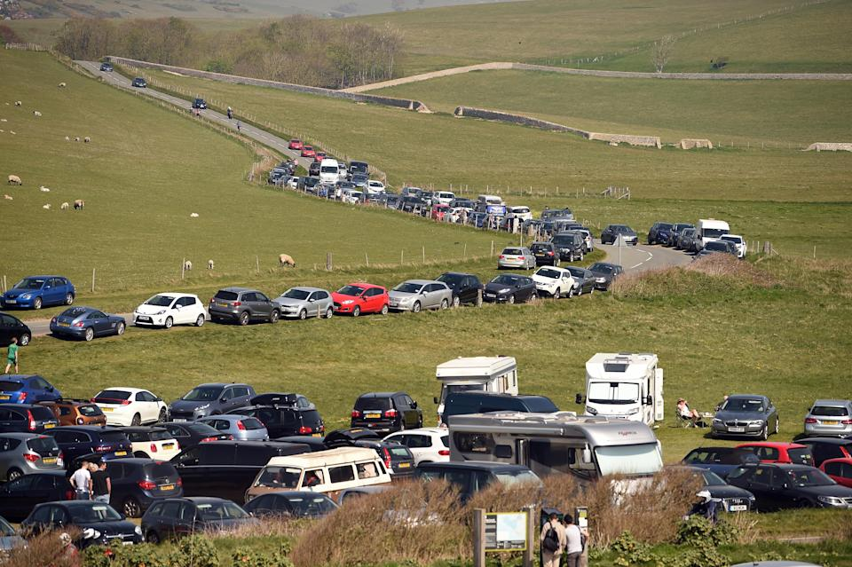 Busy car park on the cliff top during the Cadbury Easter Egg Hunt at Birling Gap and the Seven Sisters, East Sussex