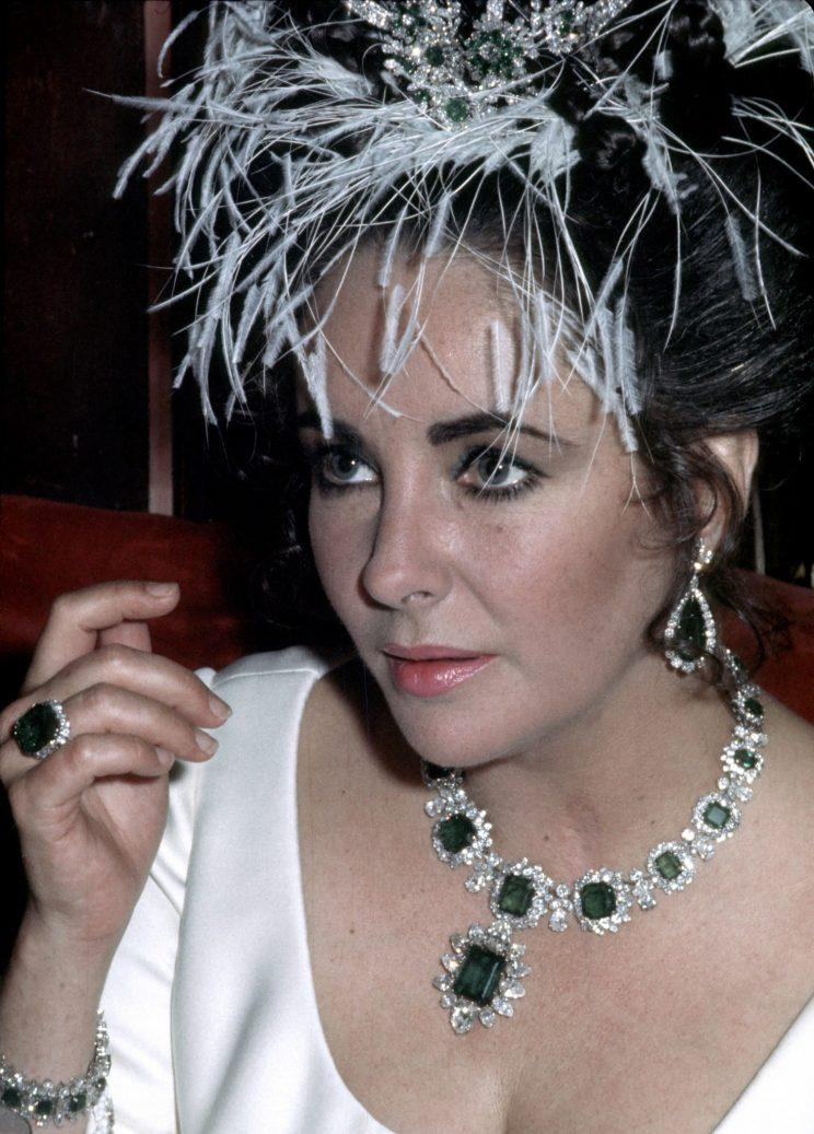 Elizabeth Taylor's jewelry, art, and fashion items raked in $115.9 million. (Photo: Getty Images)