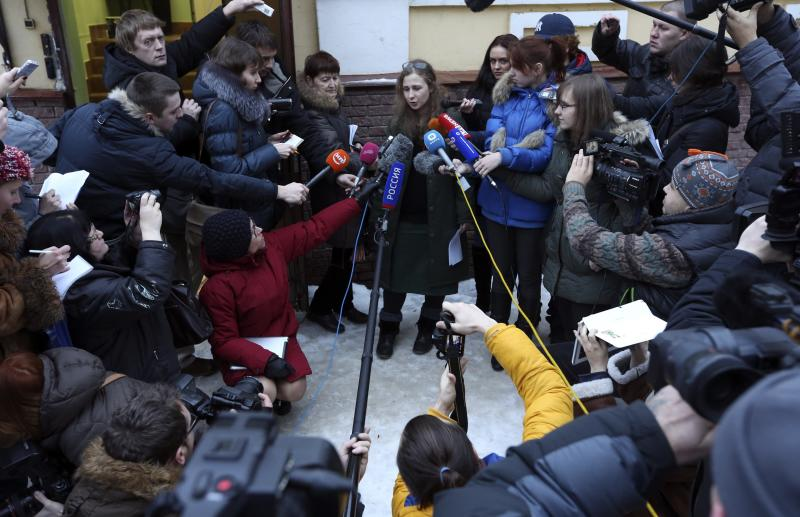 Maria Alyokhina (C), member of Russian punk band Pussy Riot, speaks to the media after her release from a penal colony in Nizhny Novgorod December 23, 2013. Alyokhina walked free from jail on Monday under an amnesty allowing her early release from a two-year sentence for a protest in a church against President Vladimir Putin. REUTERS/Sergei Karpukhin (RUSSIA - Tags: POLITICS CRIME LAW)