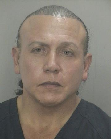 FILE PHOTO: Cesar Altieri Sayoc is pictured in Ft. Lauderdale, Florida, U.S. in this November 28, 2013 handout booking photo obtained by Reuters Oct. 26, 2018.  Broward County Sheriff's Office/Handout via Reuters/File Photo