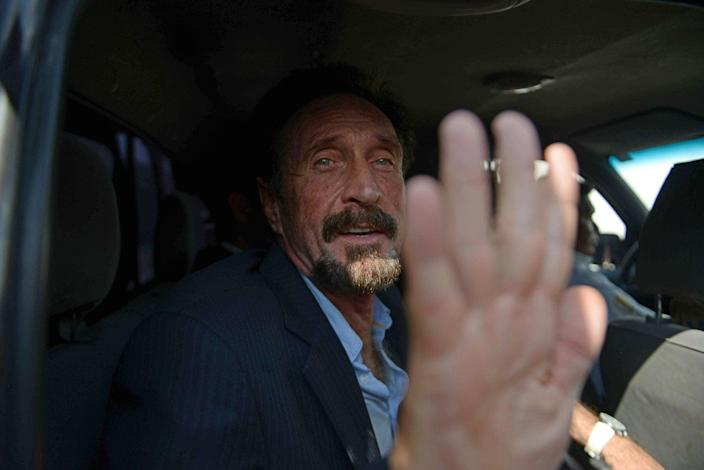US anti-virus software pioneer John McAfee gestures as he arrives at the Aurora international airport in Guatemala City. McAfee escaped immediate deportation to Belize on Wednesday as Guatemala decided to expel the American back to the United States instead. McAfee, who entered Guatemala illegally after more than three weeks on the run, is wanted in Belize for questioning over his neighbor's murder last month. JOHAN ORDONEZ/AFP/Getty Images