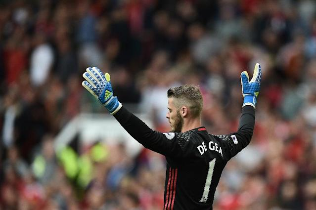 Manchester United goalkeeper David de Gea pulled off a pair of impressive second-half saves against Liverpool (AFP Photo/Oli Scarff)
