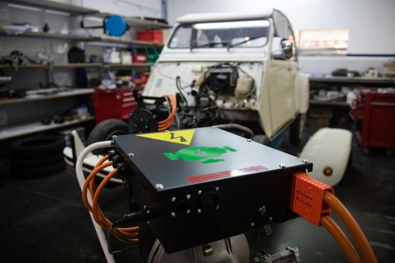 A classic Citroen 2CV getting retrofitted with an electric motor and battery pack