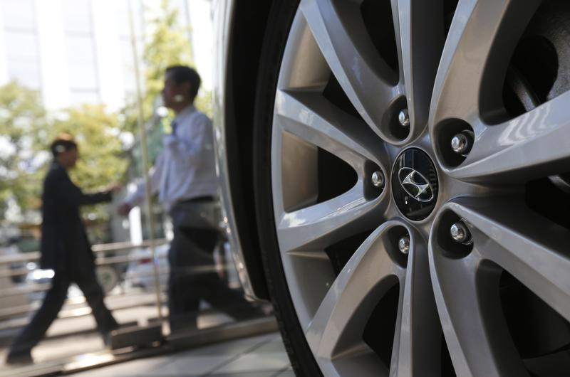 The logo of Hyundai Motor Co. is seen on a wheel of a car at a Hyundai dealership in Seoul