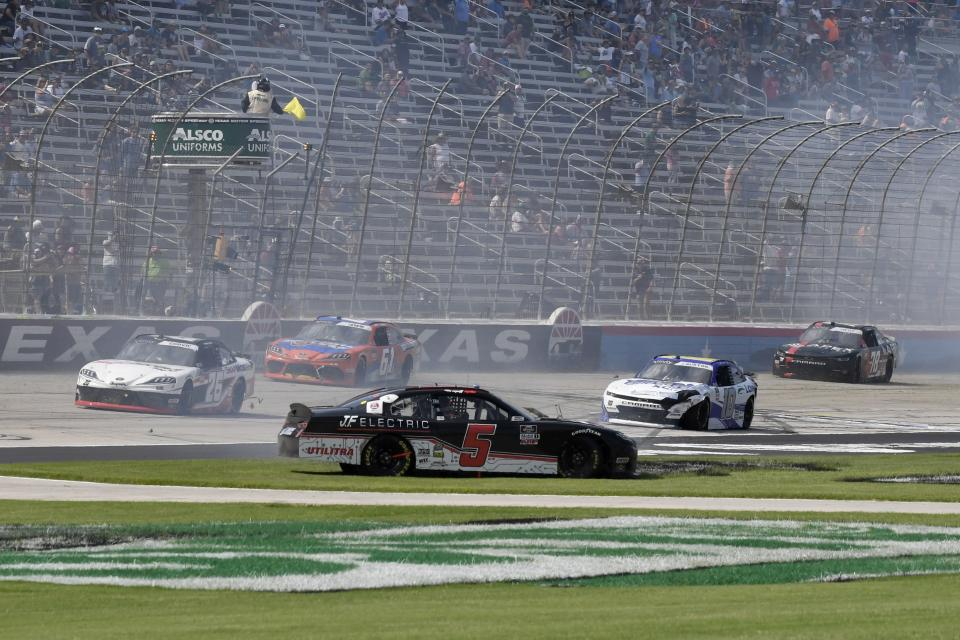 Matt Mills (5) and Jeb Burton (10) crash along the front stretch during a NASCAR Xfinity Series auto race at Texas Motor Speedway in Fort Worth, Texas, Saturday, June 12, 2021. (AP Photo/Larry Papke)