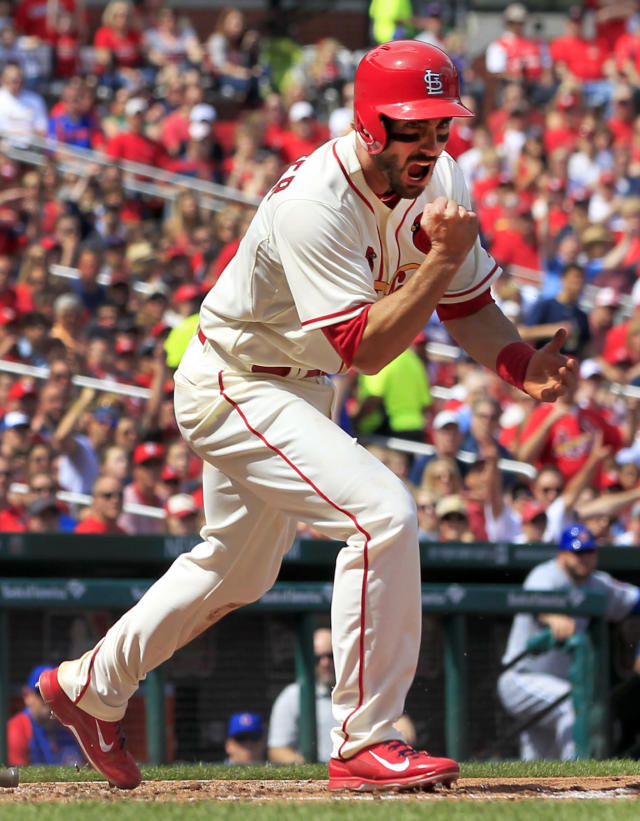 St. Louis Cardinals' Matt Carpenter celebrates after scoring on a fielder's choice during the fourth inning of a baseball game against the Chicago Cubs, Saturday, April 12, 2014, in St. Louis. (AP Photo/Jeff Roberson)