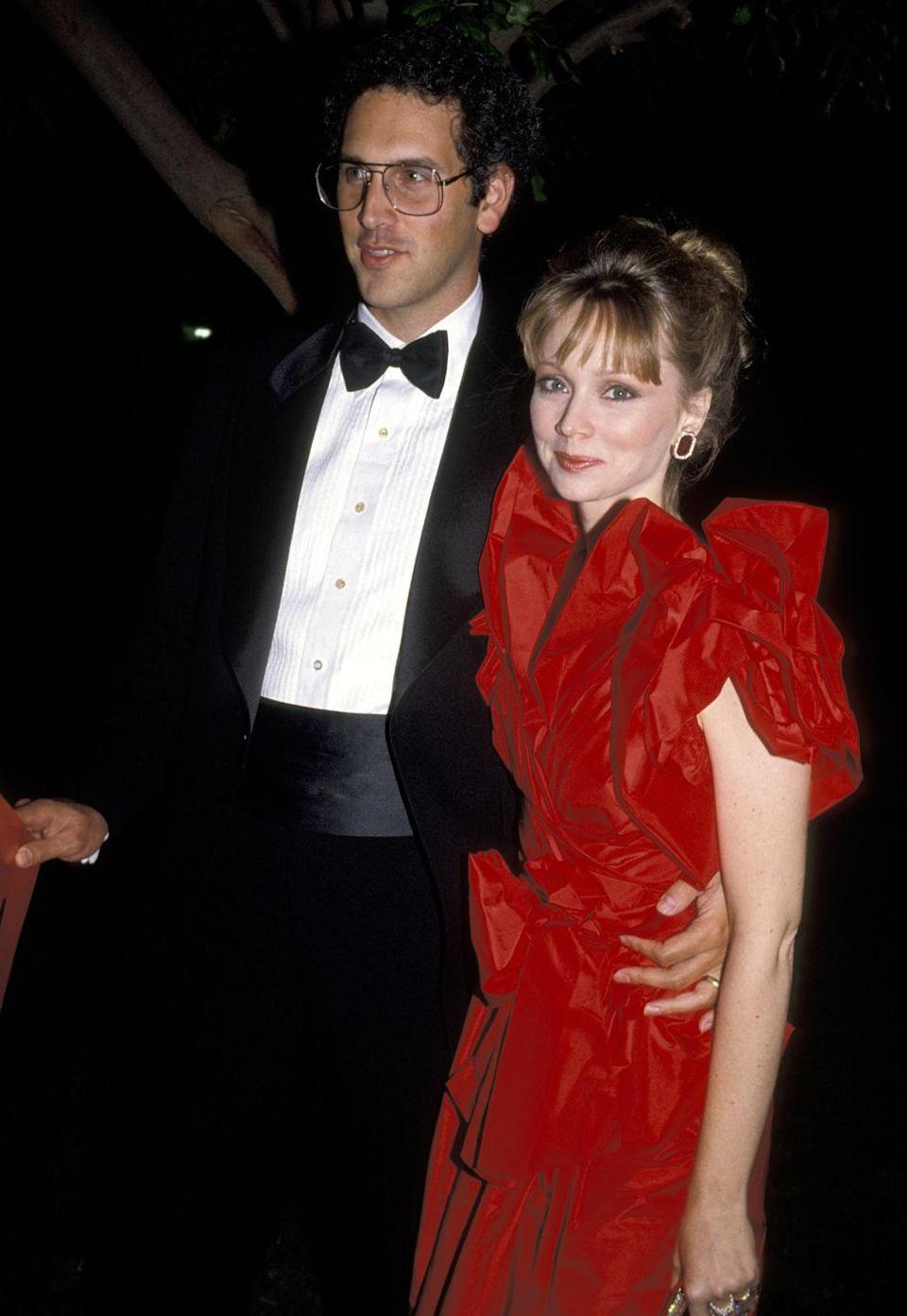 <p>This red gown looked stunning on Diane, umm, I mean Shelley, at the '84 Emmy awards. Complete with a chic updo, gold earrings, and puff sleeves, it was definitely an '80s vibe. </p>