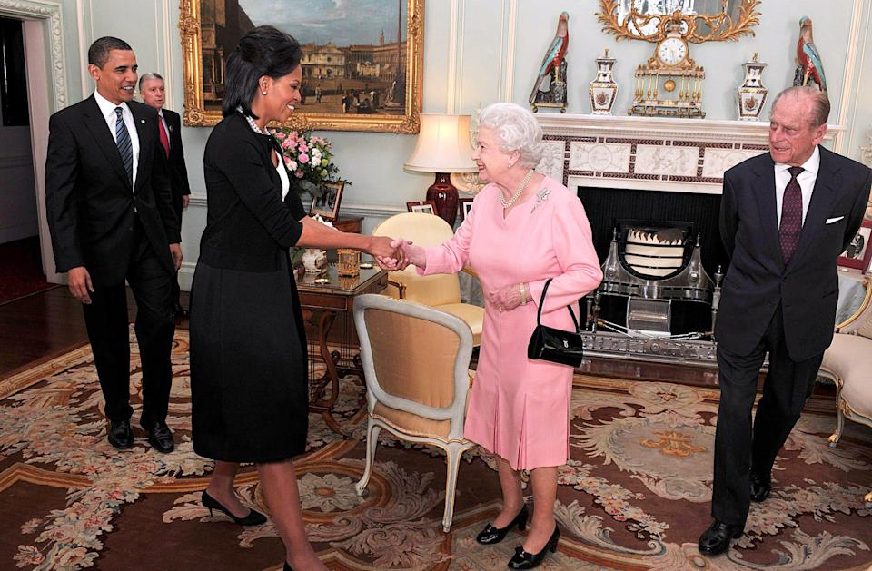 President Barack Obama and first lady Michelle Obama meet with Queen Elizabeth II and Prince Philip during an audience at Buckingham Palace on April 1, 2009 in London.