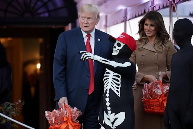 <p>President Donald Trump (L) and first lady Melania Trump host Halloween at the White House on the South Lawn Oct. 30, 2017 in Washington, D.C. The first couple gave cookies away to costumed trick-or-treaters one day before the Halloween holiday. (Photo: Chip Somodevilla/Getty Images) </p>