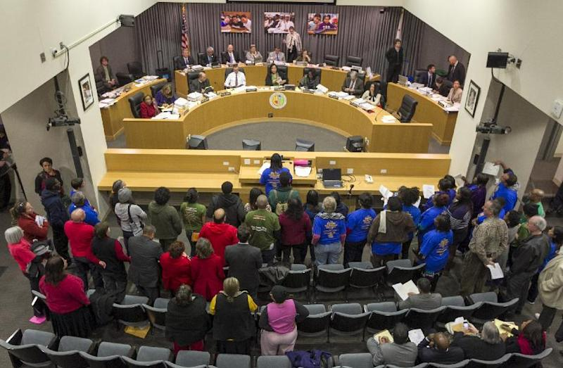 In this photo taken Tuesday, Jan. 15, 2013, parents, teachers and students of Crenshaw High School protest at a board meeting of the Los Angeles Unified School District headquarters to try to stop the conversion of the school to a magnet program in Los Angeles Tuesday, Jan. 15, 2013. A backlash against drastic school reforms is growing across the nation. (AP Photo/Damian Dovarganes)
