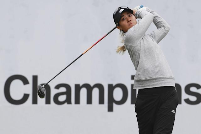 Danielle Kang of the United States watches her shot on the first hole during the first round of the LPGA tournament at LPGA International Busan in Busan, South Korea, Thursday, Oct. 24, 2019. (Han Jong-chan/Yonhap via AP)