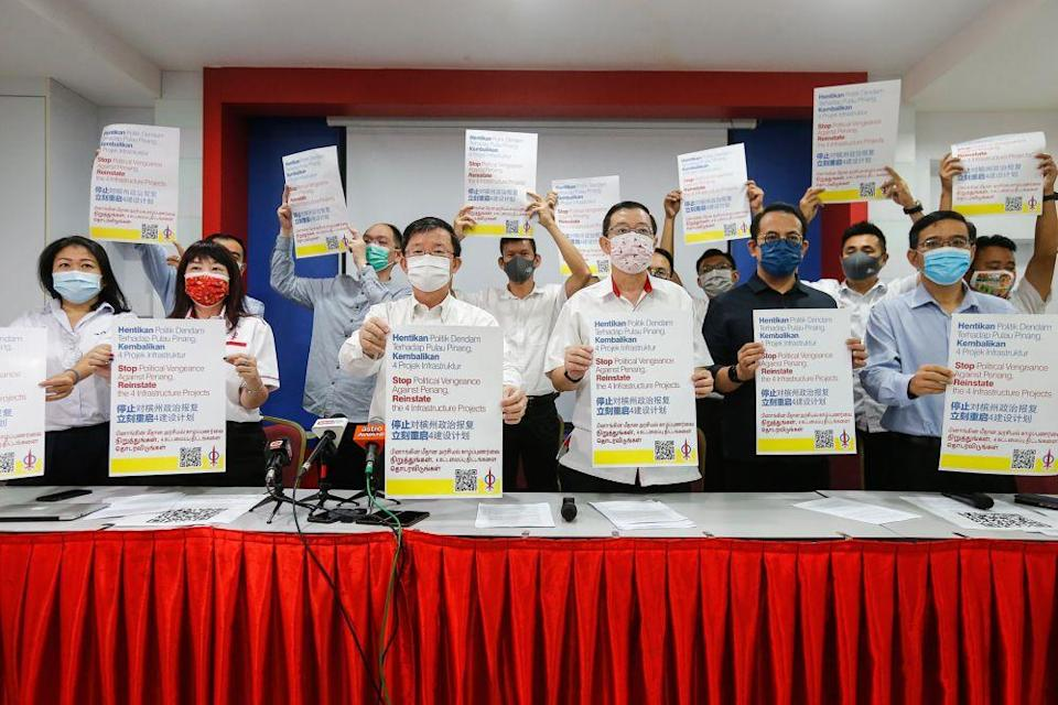 Penang DAP chairman Chow Kon Yeow (third from left), along with other party members, hold up placards demanding the reinstatement of state infrastructure projects at Wisma DAP in George Town January 7, 2021. — Picture by Sayuti Zainudin