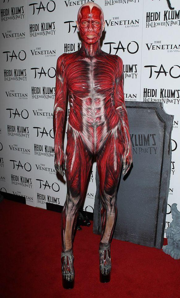<p>No. 2: At her first party in 2011 (she had two that year), Klum arrived in an anatomy-inspired ensemble with a hand-painted bodysuit displaying bones, muscles, veins, and tendons. The look, which took three and a half hours to put together, also included gross yellow prosthetic teeth and red contact lenses. Making it a little playful? Gigantic platform shoes. The best part, however, was that she arrived on a stretcher. Two blood-covered doctors wheeled her down the red carpet and into the bash. Bloody perfect! (Photo: Getty Images) </p>