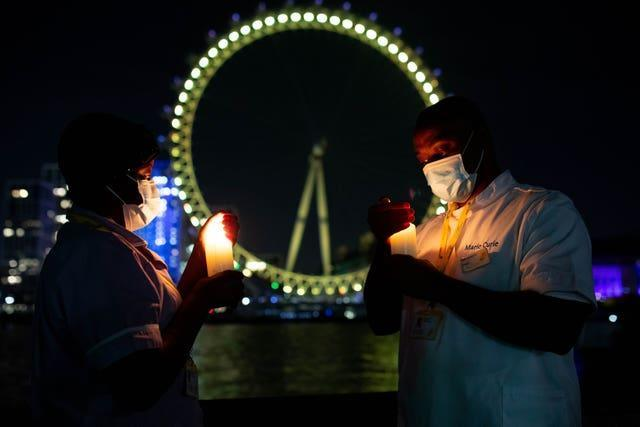 Nurses stand at the London Eye to mark Marie Curie's inaugural National Day of Reflection