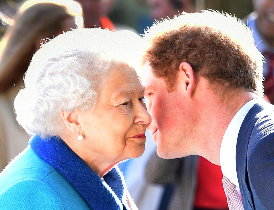 Prince Harry kisses the Queen on the cheek