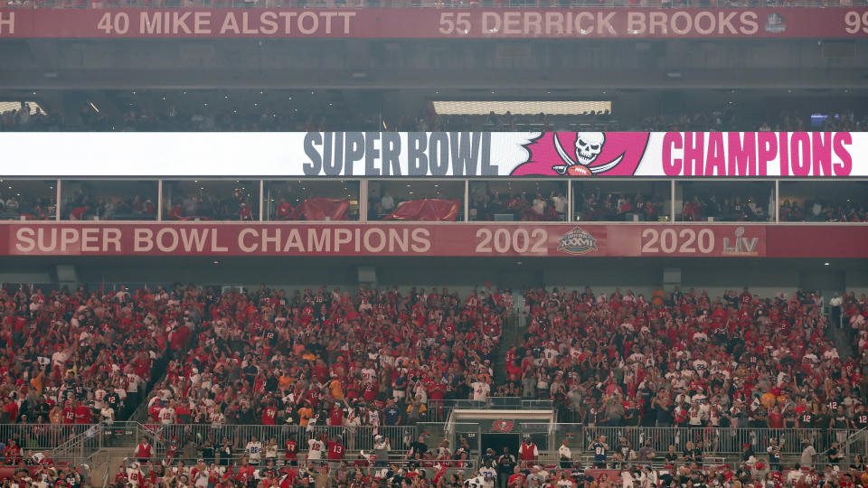 The Tampa Bay Buccaneers uncover their 2020 Super Bowl banner before an NFL football game against the Dallas Cowboys Thursday, Sept. 9, 2021, in Tampa, Fla. (AP Photo/Mark LoMoglio)