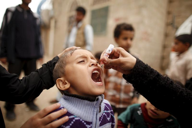 A boy receives polio vaccination drops during a house-to-house vaccination campaign in Yemen's capital, Sanaa, on April 10, 2016.