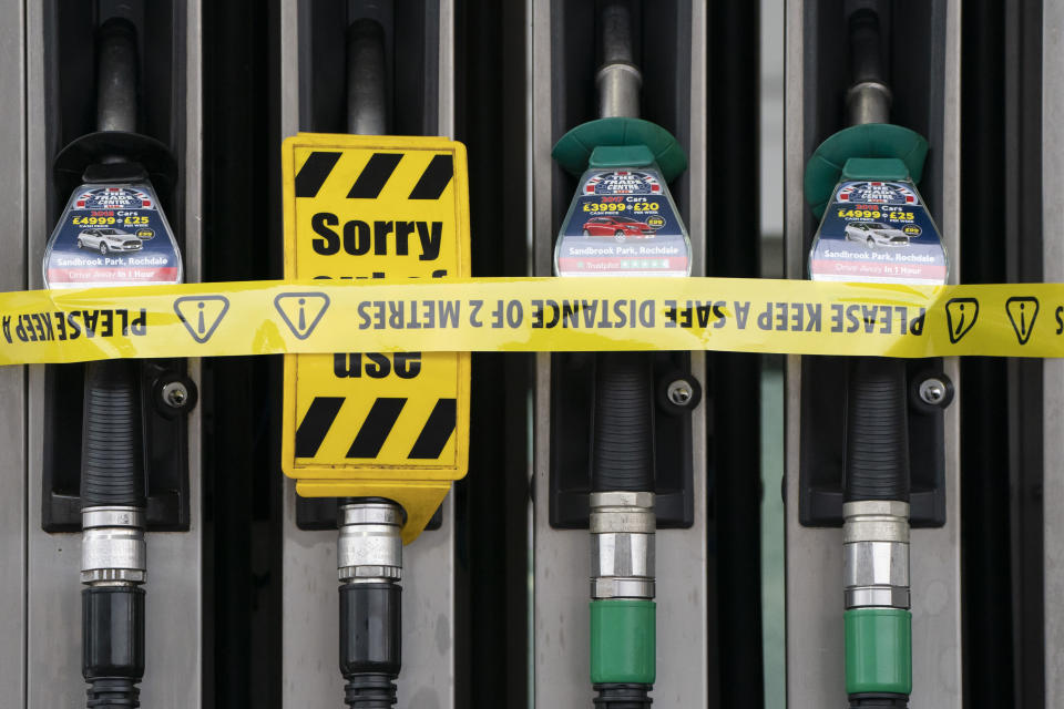 A veiw of closed pumps at a petrol station in Manchester, England, Tuesday, Sept. 28, 2021. Thousands of British gas stations have run dry, as motorists scrambled to fill up amid a supply disruption due to a shortage of truck drivers. Long lines of vehicles formed at many gas stations over the weekend, and tempers frayed as some drivers waited for hours. ( AP Photo/Jon Super)