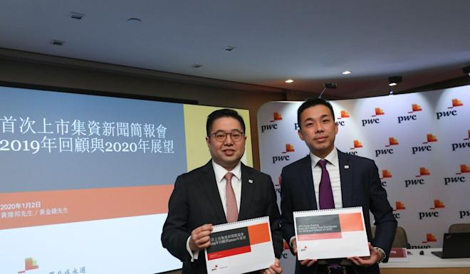 Benson Wong, left, and Eddie Wong of PwC Hong Kong present the accounting firm's 'IPO Market Year End Review for 2019 and Outlook for 2020' report on Thursday. Photo: Nora Tam