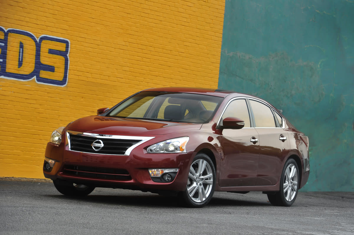 This undated photo provided by Nissan shows the 2013 Nissan Altima Sedan. This fifth-generation Altima, with a federal government's rating of 27 miles per gallon in city driving and 38 mpg on the highway, is slightly larger and has more power than its predecessor and is restyled inside and out for a more upscale appearance. (AP Photo/Nissan)