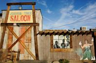 """<p><strong>What is this place?</strong><br> This dusty dive bar is the gateway to Joshua Tree National Park.</p> <p><strong>So who's there?</strong><br> You'll find <a href=""""https://www.cntraveler.com/gallery/best-hikes-in-los-angeles?mbid=synd_yahoo_rss"""" rel=""""nofollow noopener"""" target=""""_blank"""" data-ylk=""""slk:hikers and climbers"""" class=""""link rapid-noclick-resp"""">hikers and climbers</a> from out of town, Marines from the nearby Twenty Nine Palms base, and local folk looking for a kick.</p> <p><strong>How are the drinks?</strong><br> You're not going to find any froo froo cocktails here; just a solid list of the classic domestic beers (plus a few craft offerings) and staple spirits.</p> <p><strong>What do they have to eat?</strong><br> Classic bar bites like burgers, jalapeño poppers, fish and chips, and a solid basket of ribs.</p> <p><strong>Did the staff do you right?</strong><br> A saloon like this wouldn't be complete without the cast of characters that work the bar. They're attentive lifers with good humor and plenty of stories to tell.</p> <p><strong>Wrap it up: what are we coming here for?</strong><br> This is a great spot for a bite and a beer when you first arrive into town—and to get yourself slowed down to J-Tree pace—or for a hearty meal after a long day of hiking.</p>"""