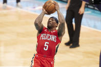 New Orleans Pelicans guard Eric Bledsoe (5) attempts a jump shot during the first half of an NBA basketball game against the Charlotte Hornets, Sunday, May 9, 2021, in Charlotte, N.C. (AP Photo/Brian Westerholt)