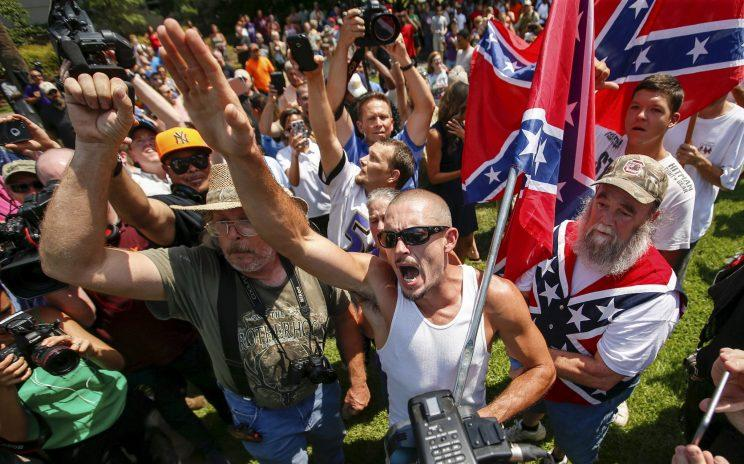 Supporters of the Ku Klux Klan confront opposing demonstrators during a rally last year at the Columbia, S.C., statehouse. (Photo: Chris Keane/Reuters)
