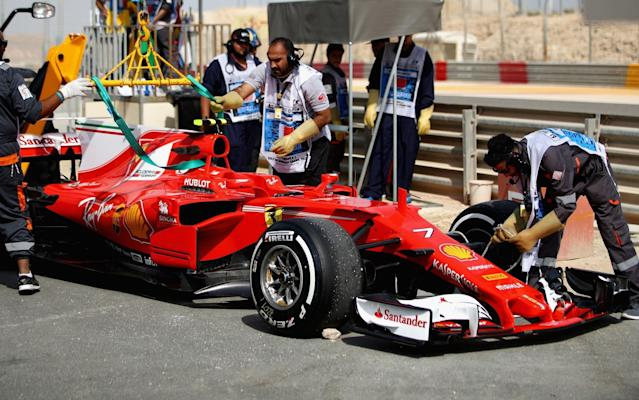 <span>Kimi Raikkonen's Ferrari is removed from the track in Bahrain</span> <span>Credit: Getty Images </span>
