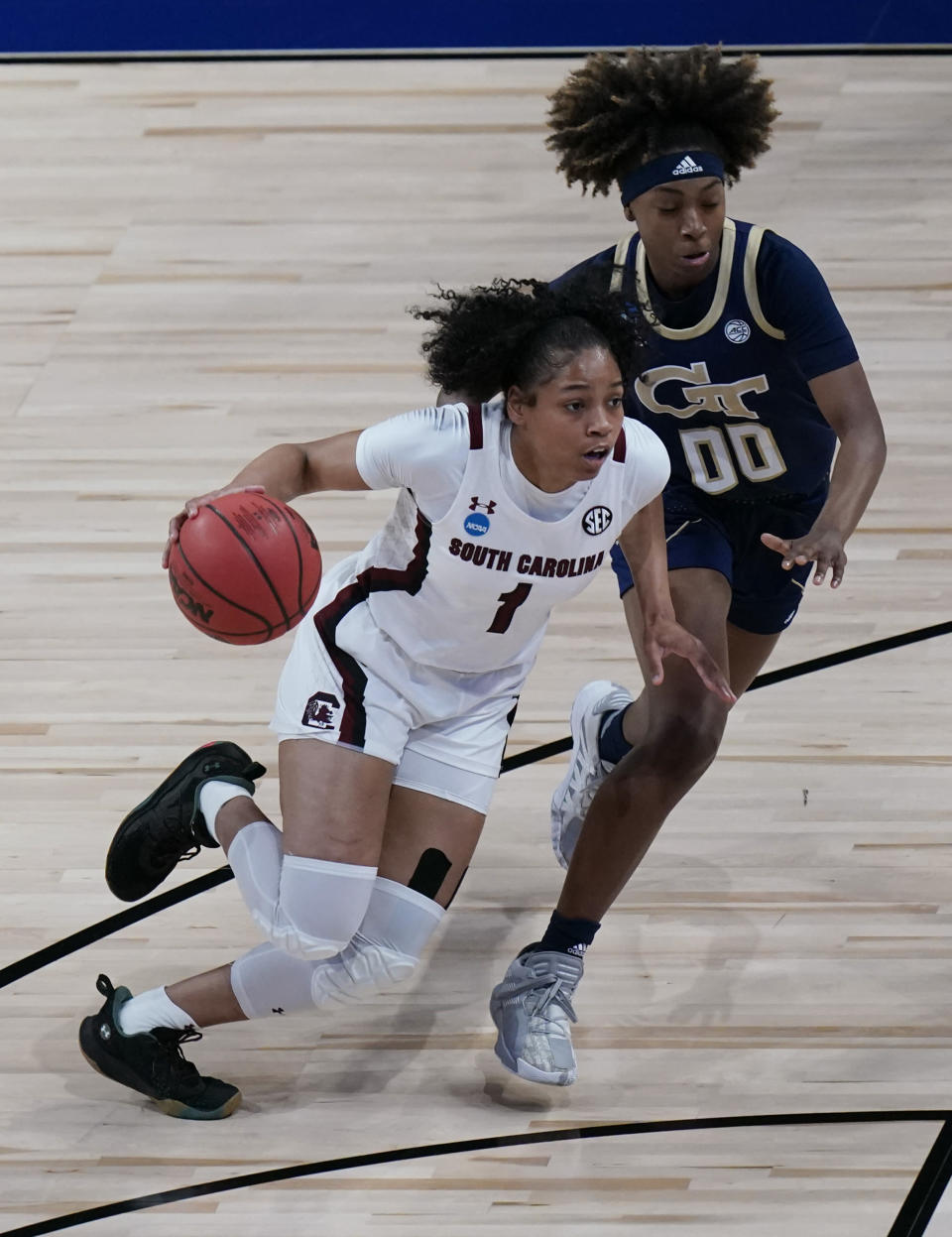 South Carolina guard Zia Cooke (1) drives around Georgia Tech guard Loyal McQueen (00) during the first half of a college basketball game in the Sweet Sixteen round of the women's NCAA tournament at the Alamodome in San Antonio, Sunday, March 28, 2021. (AP Photo/Eric Gay)