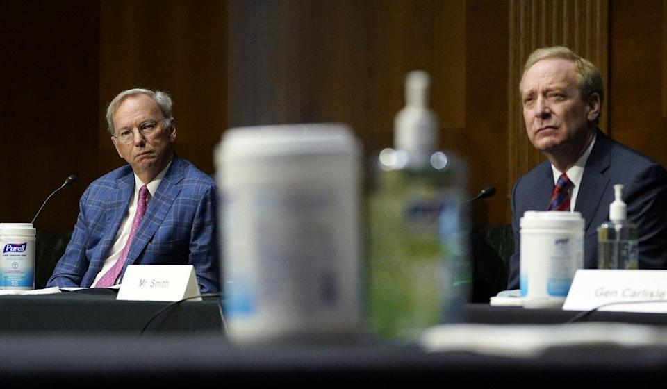 Eric Schmidt (at left) and Brad Smith, president of Microsoft Corporation, at Capitol Hill in Washington on Tuesday during a hearing on emerging technologies and their impact on national security. Photo: AP
