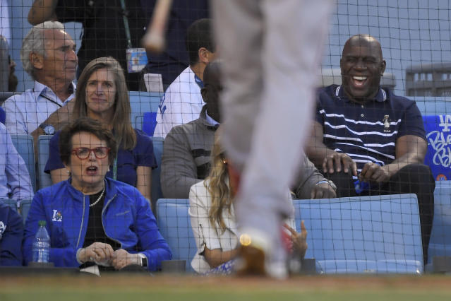 Billie Jean King, left, and Magic Johnson watch during the first inning of Game 1 in baseball's National League Divisional Series between the Los Angeles Dodgers and the Washington Nationals on Thursday, Oct. 3, 2019, in Los Angeles. (AP Photo/Mark J. Terrill)