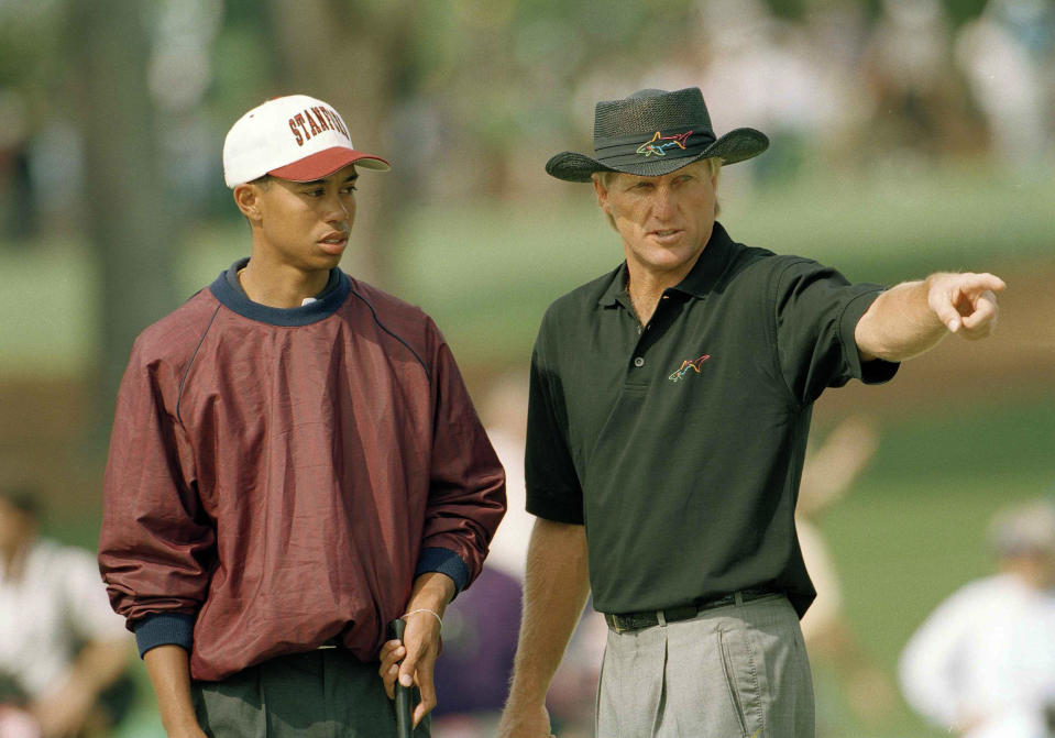<p>U.S. Amateur Champion Tiger Woods, left, talks with Greg Norman, of Australia, on number two during practice for the 1995 Masters on the Augusta National Golf Club in Augusta, Ga., April 4, 1995. (AP Photo/Dave Martin) </p>