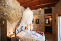 "<p>In fifth place, a luxurious stone villa has stolen the attention. Based in Crete, the property – which has been carved from natural rock – has been wish listed over 76,658 times. Once a family home, the villa has a traditional feel with a balcony which offers tough-to-beat views of Kissamos Bay. <strong><a href=""https://www.airbnb.co.uk/rooms/337642"" rel=""nofollow noopener"" target=""_blank"" data-ylk=""slk:Book now"" class=""link rapid-noclick-resp"">Book now</a></strong>. <em>[Photo: Caters]</em> </p>"
