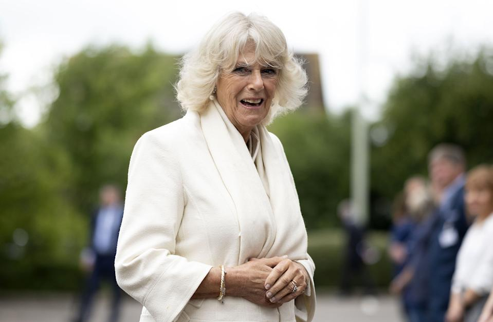 Britain's Camilla, Duchess of Cornwall reacts during her visit to the Turnbull & Asser shirt factory in Gloucester, southwest England on July 9, 2020. - At the height of the COVID-19 pandemic, the shirt manufacturer switched their entire production line to making scrubs for Britain's NHS (National Health Service). (Photo by Matthew Horwood / POOL / AFP) (Photo by MATTHEW HORWOOD/POOL/AFP via Getty Images)