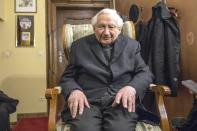 FILE - In this Monday Feb. 11, 2013 file photo, Georg Ratzinger, brother of Pope Benedict XVI , sits in his house in Regensburg, southern Germany. The Rev. Georg Ratzinger, the older brother of Emeritus Pope Benedict XVI, who earned renown in his own right as a director of an acclaimed German boys' choir, has died at age 96. The Regensburg diocese in Bavaria, where Ratzinger lived, said in a statement on his website that he died on Wednesday, July 1, 2020. (AP Photo/dpa, Armin Weigel)/dpa via AP)