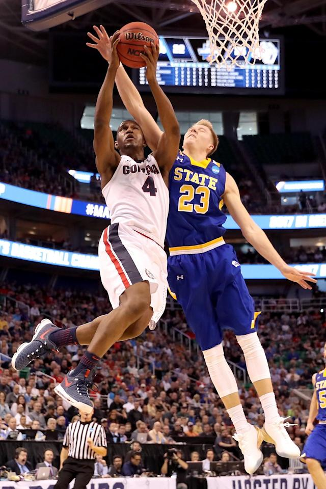 <p>Jordan Mathews #4 of the Gonzaga Bulldogs drives to the basket against Reed Tellinghuisen #23 of the South Dakota State Jackrabbits in the first half during the first round of the 2017 NCAA Men's Basketball Tournament at Vivint Smart Home Arena on March 16, 2017 in Salt Lake City, Utah. (Photo by Christian Petersen/Getty Images) </p>