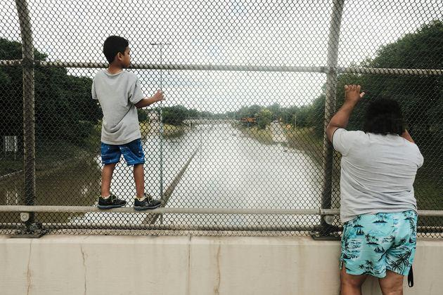 Detroit residents observe a stretch of I-94 under several feet of water after rains flooded parts of Metro Detroit last month. (Photo: SOPA Images via Getty Images)