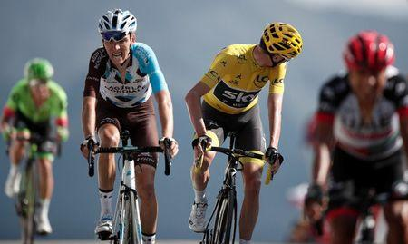 Cycling - The 104th Tour de France cycling race - The 179.5-km Stage 18 from Briancon to Izoard, France - July 20, 2017 - AG2R-La Mondiale rider Romain Bardet of France and Team Sky rider and yellow jersey Chris Froome of Britain on the finish line. REUTERS/Benoit Tessier