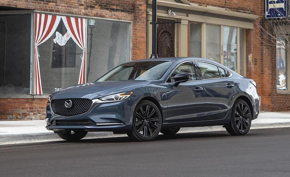 """<p>In addition to its knockout looks and eager driving dynamics, the <a href=""""https://www.caranddriver.com/mazda/mazda-6"""" rel=""""nofollow noopener"""" target=""""_blank"""" data-ylk=""""slk:Mazda 6"""" class=""""link rapid-noclick-resp"""">Mazda 6</a> family sedan is also one of the safest choices in its class. It earned its <a href=""""https://www.iihs.org/ratings/vehicle/mazda/6-4-door-sedan/2021"""" rel=""""nofollow noopener"""" target=""""_blank"""" data-ylk=""""slk:Top Safety Pick+ designation"""" class=""""link rapid-noclick-resp"""">Top Safety Pick+ designation</a> easily, with Good crash test scores, a score of Superior for its standard driver-assistance features, and an Acceptable rating for its standard headlamps. Opting for the 6's LED projector headlamps bumps that last score up to Good, but that feature is reserved for Grand Touring Reserve, Signature, or Blackout Edition trim levels. Non-premium models with LED projectors don't have curve adaptive equipment, and earned an Acceptable rating instead. You get what you pay for. </p><p><a class=""""link rapid-noclick-resp"""" href=""""https://www.caranddriver.com/reviews/a35328064/2021-mazda-6-by-the-numbers/"""" rel=""""nofollow noopener"""" target=""""_blank"""" data-ylk=""""slk:MAZDA 6 TESTED"""">MAZDA 6 TESTED</a> 