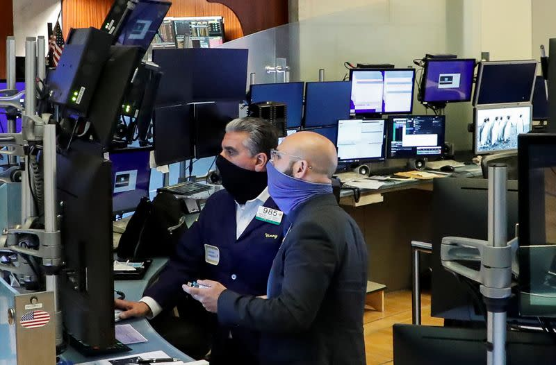 Wall Street jumps on positive start to earnings, vaccine hopes