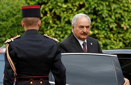 FILE PHOTO - General Khalifa Haftar, commander in the Libyan National Army, arrives to attend a meeting for talks over a political deal to help end Libya's crisis in La Celle-Saint-Cloud near Paris