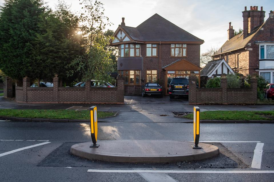 Zakir Malik described how he woke up to find a pedestrian island built outside his driveway. (SWNS)