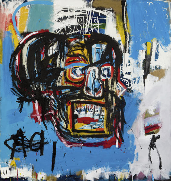 """This undated photo provided by Sotheby's shows Jean-Michel Basquiat's Masterpiece """"Untitled."""" Sotheby's said the sale of the artwork Thursday, May 18, 2017, in Manhattan was an auction record for the artist. It also set a record price for an American artist at auction. The 1982 painting depicts a face in the shape of a skull. (Sotheby's via AP)"""