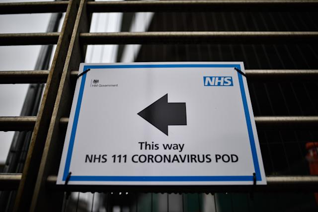 A sign directing patients towards a Coronavirus pod at University College Hospital in London. (Getty)