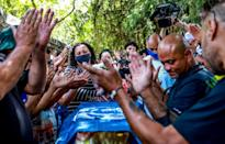 Relatives and friends of Joao Alberto Silveira Freitas, who died after being beaten by white security agents in a Carrefour supermarket, attend his funeral in Porto Alegre, Brazil, on November 21, 2020