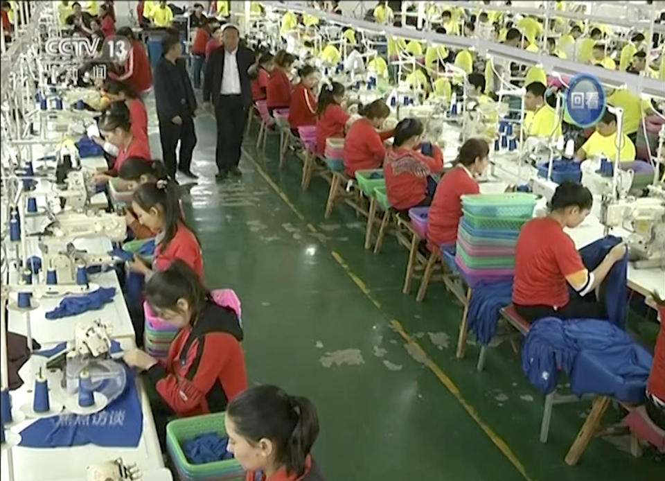 FILE - In this file image from undated video footage run by China's CCTV via AP Video, Muslim trainees work in a garment factory at the Hotan Vocational Education and Training Center in Hotan, Xinjiang, northwest China. China's state broadcaster CCTV aired the report Tuesday, Oct. 16, 2018, on the so-called vocational education and training center, with Muslim trainees telling the camera how they have been saved from dangerous and poor lives and how grateful they are to the authorities. (CCTV via AP Video, File)