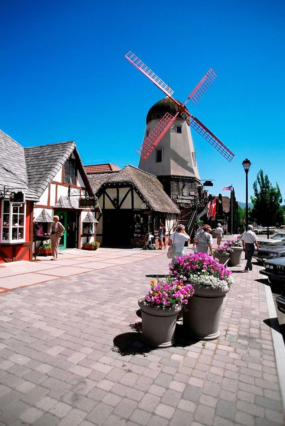 <p>Though smack dab in the middle of California's Santa Ynez wine country, Solvang feels like you've been transported to Europe. Located a short 45-minute trip from Santa Barbara, this charming Danish town of 5,909 is so worth a day trip, pit stop while road tripping through the state, and full-on vacation. In fact, you'll probably want to move there full time. </p>